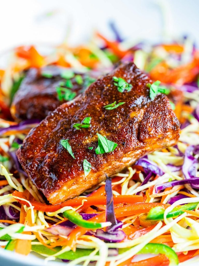 oven baked salmon with spice rub on rainbow slaw salad