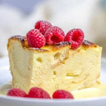 custard bread pudding with vanilla sauce and raspberries