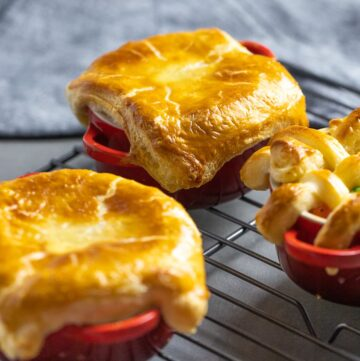 easy chicken pot pie with puff pastry in red ramekins