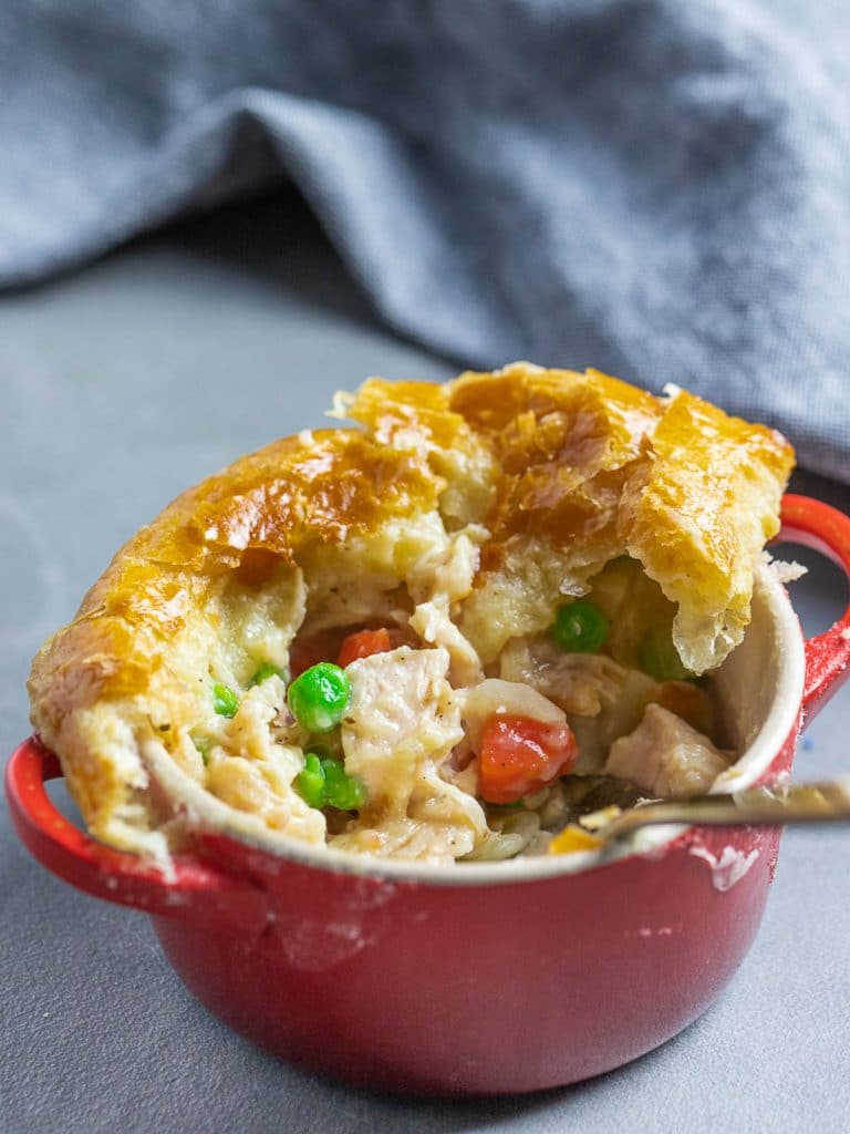 easy chicken pot pie with puff pastry in red ramekin