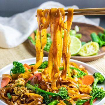 pad see ew thai noodles on chopsticks with vegetables