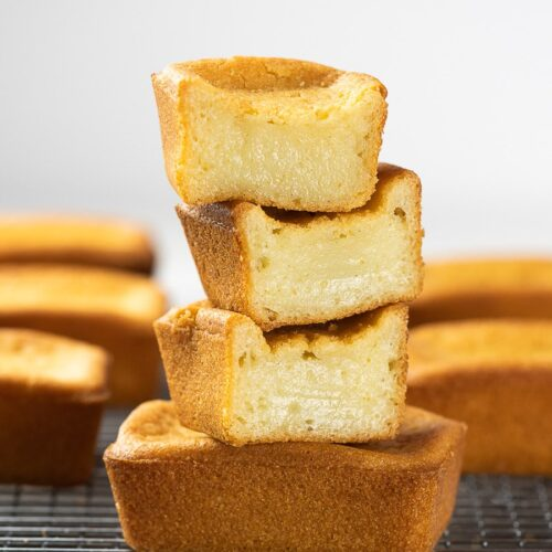 butter mochi stacked on top of a wire rack