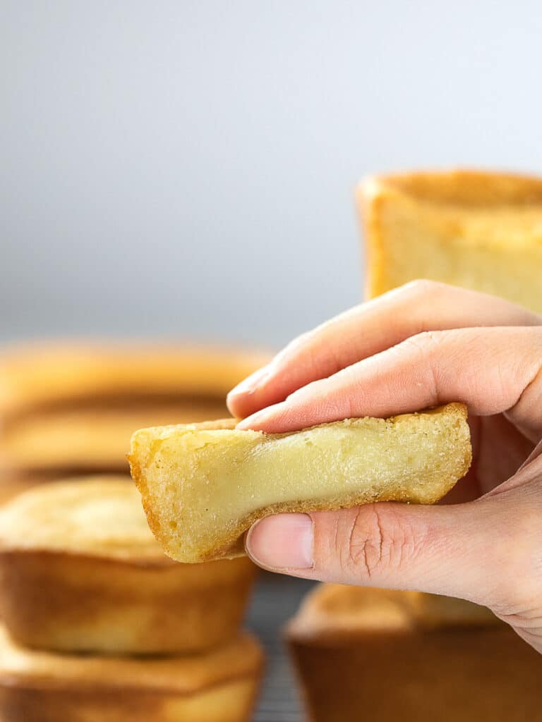 butter mochi held by hand