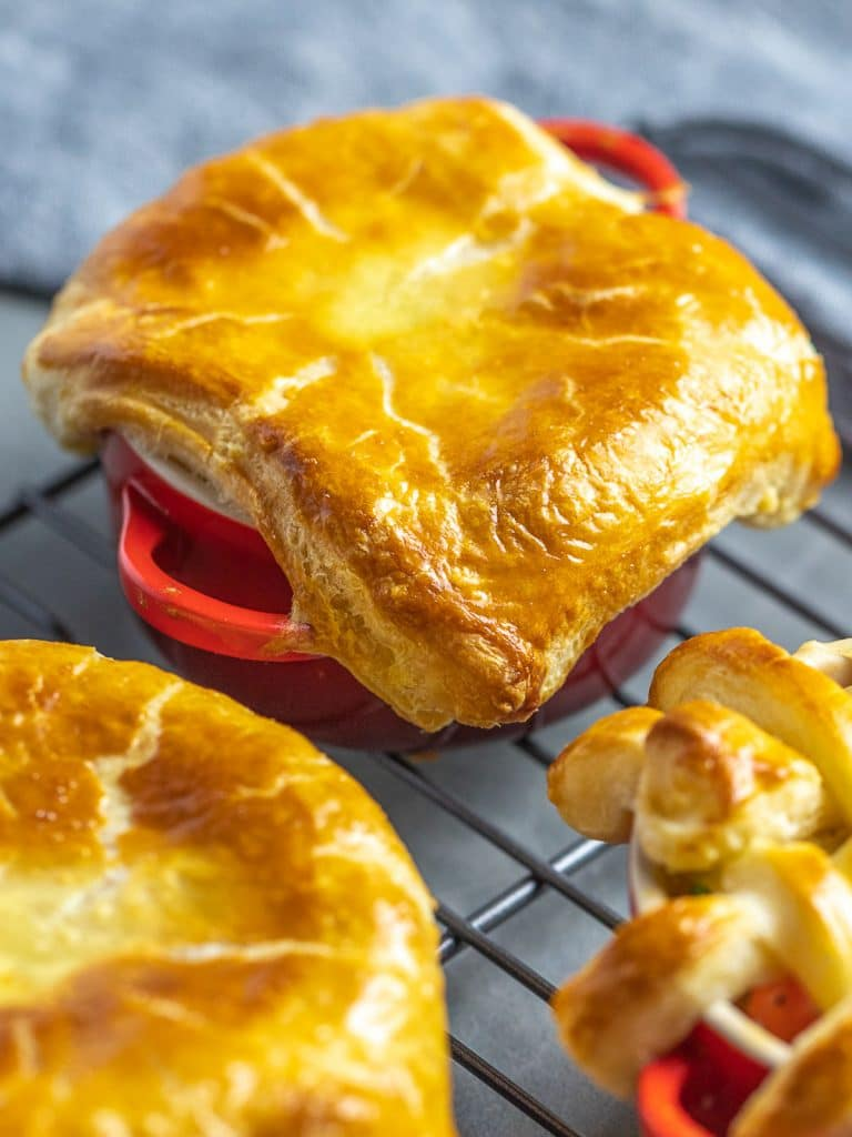easy chicken pot pie with puff pastry crust in red ramekins