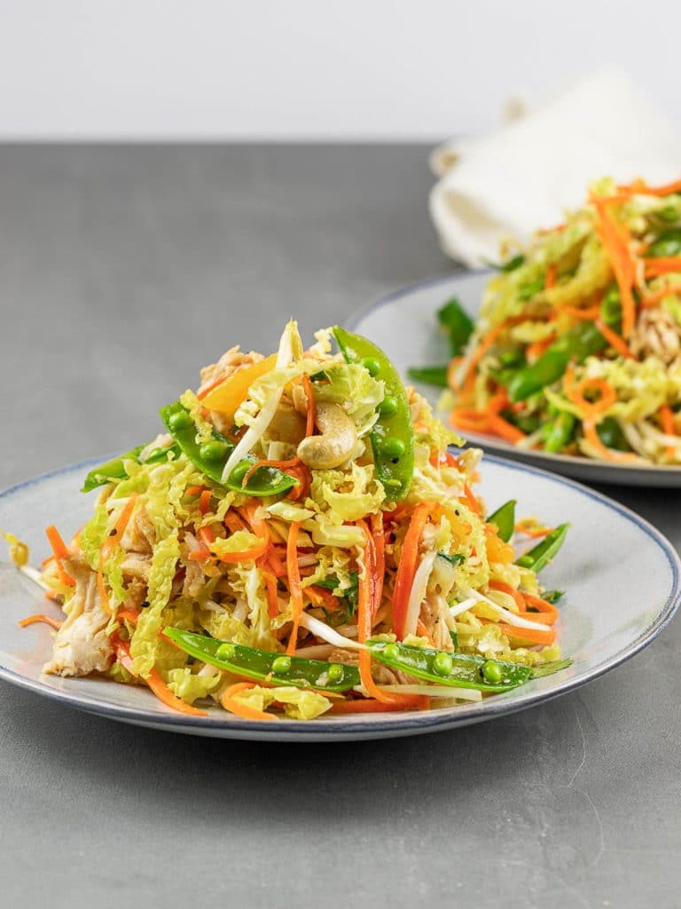 healthy Chinese chicken salad on a blue plate
