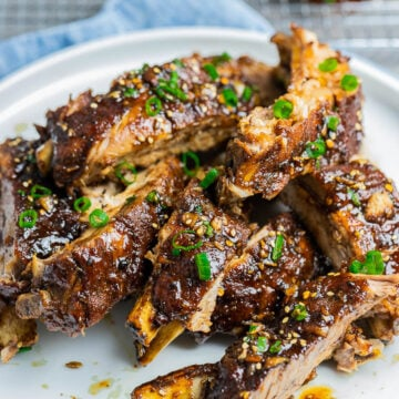 Instant Pot Asian Ribs on a white plate garnished with scallions