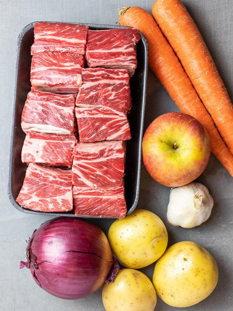 korean short ribs, carrots, apple, red onion, potatoes, and garlic