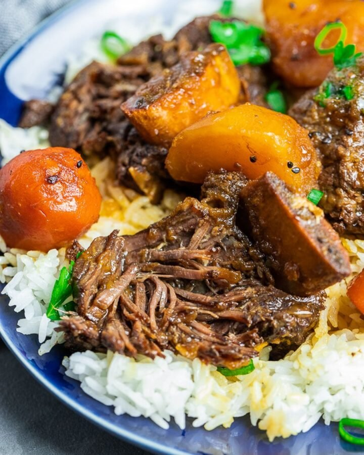 Korean short ribs with potatoes and carrots with rice on a blue plate