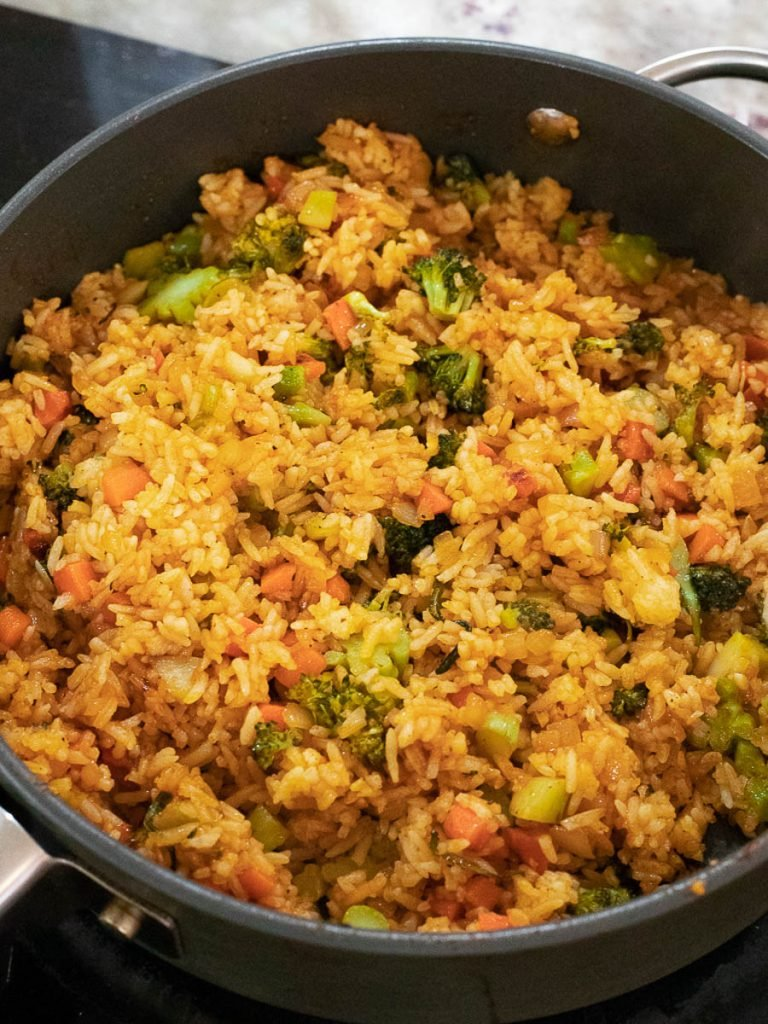 ketchup fried rice in a pan with vegetables