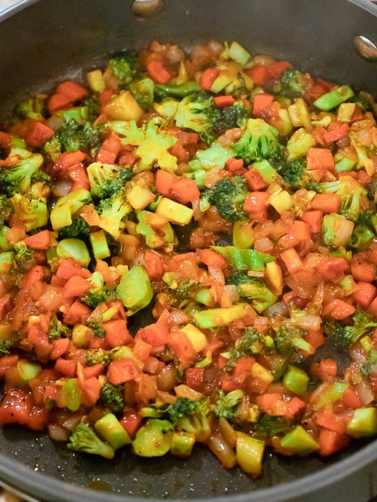 ketchup fried rice with vegetables in a pan