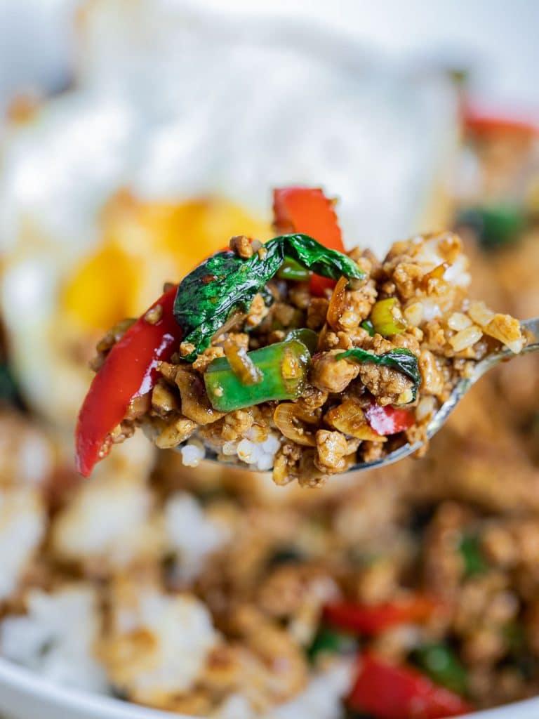 Vegetarian Thai Basil Tofu Stir Fry (Pad Krapow) on a spoon