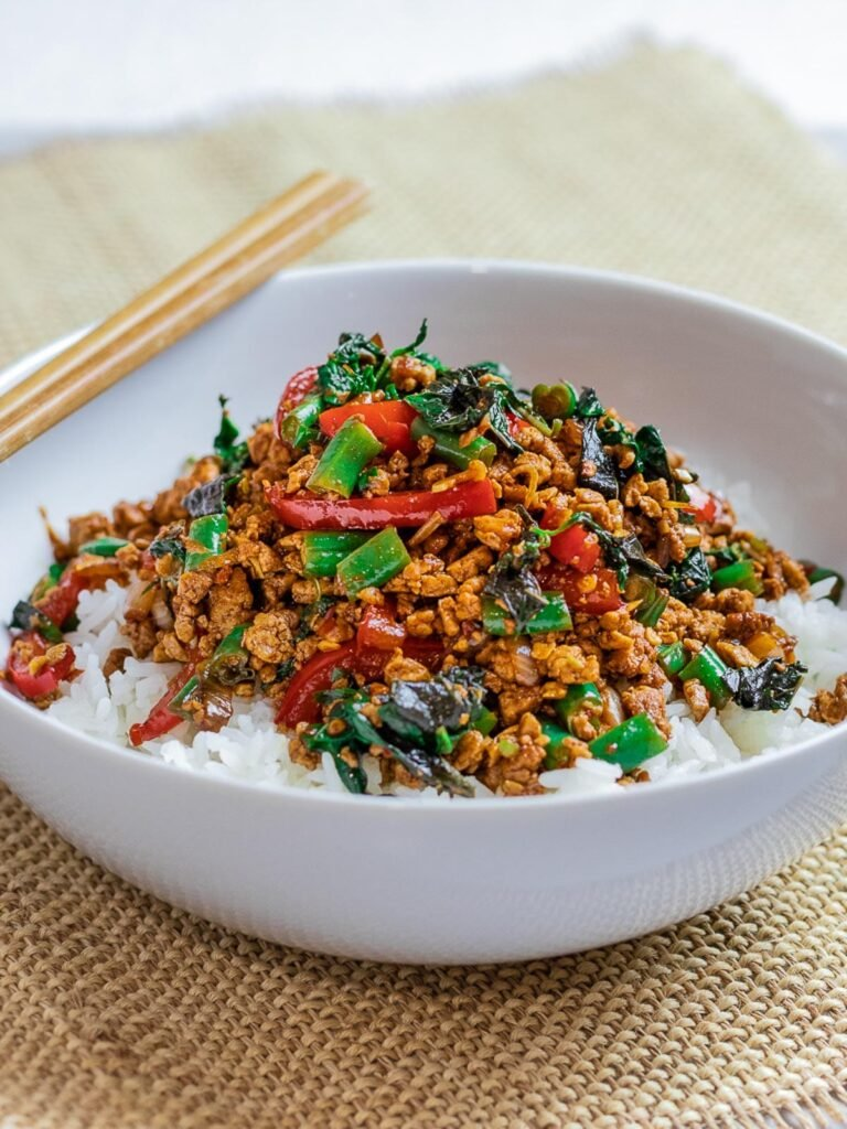 Vegetarian Thai Basil Tofu Stir Fry (Pad Krapow) in a white bowl with chopsticks