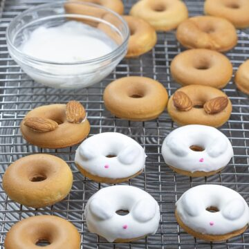 Easter bunny donuts with white candy melt on top of a cooling rack