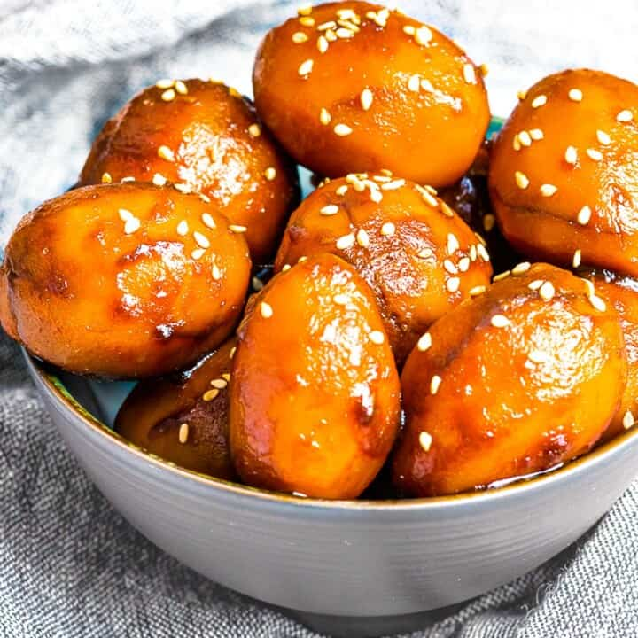Korean Potato Side Dish, Gamja Jorim in a grey bowl on top of linen