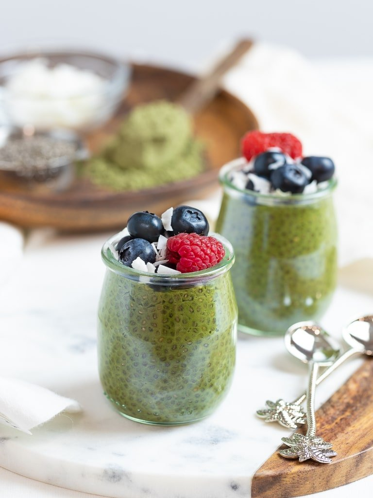 keto matcha chia pudding with blueberries and raspberries