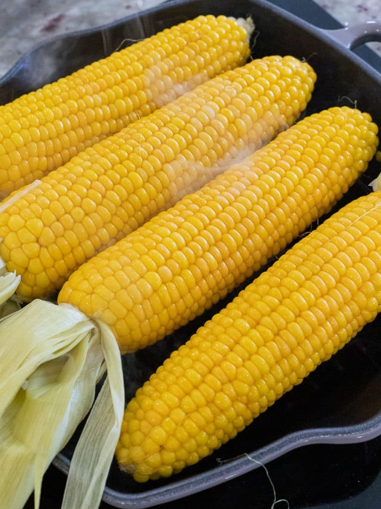 yellow corn on the cob on a grill pan