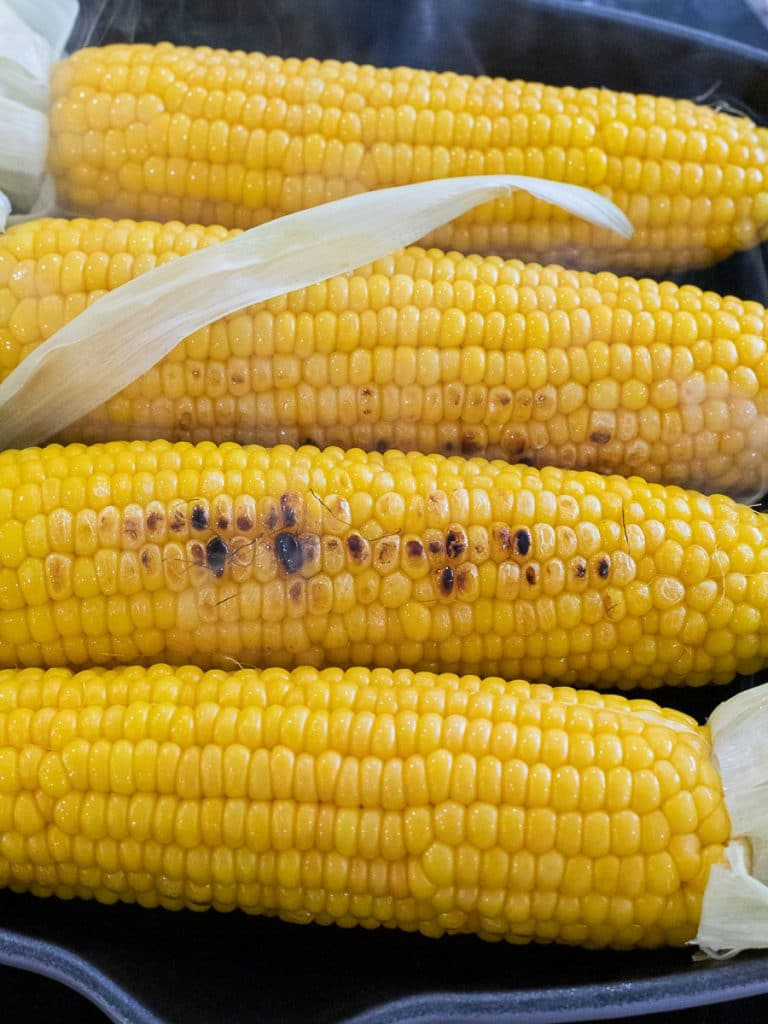 yellow corn on the cob in a grill pan
