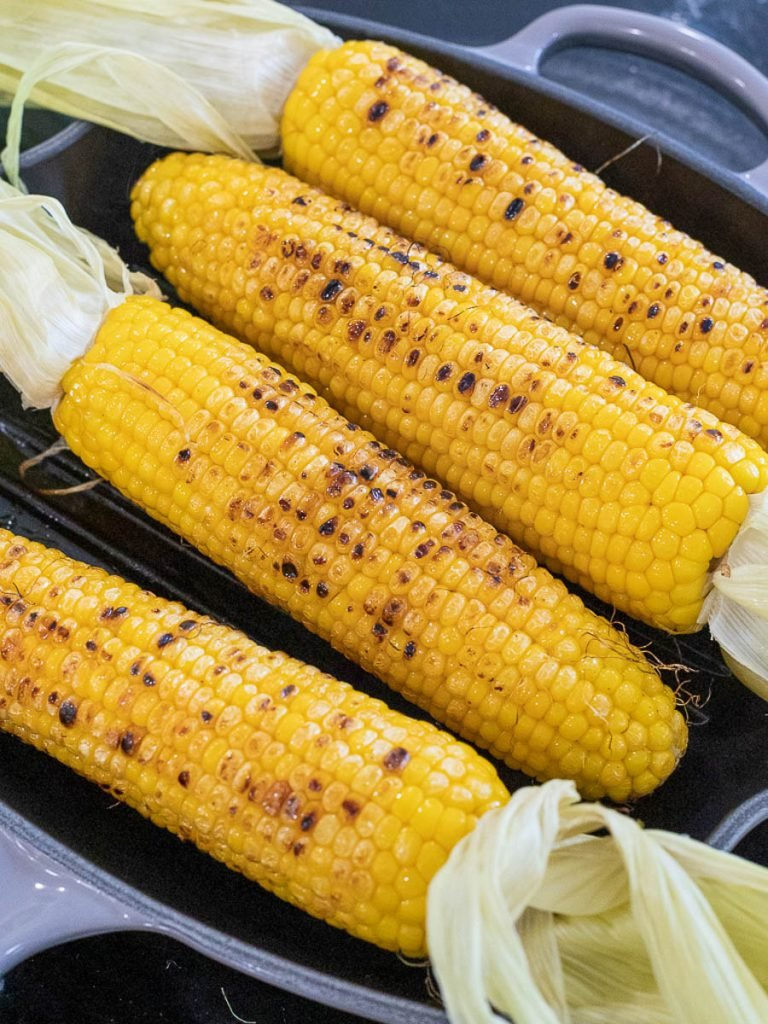 grilled yellow corn on the cob on a grill pan