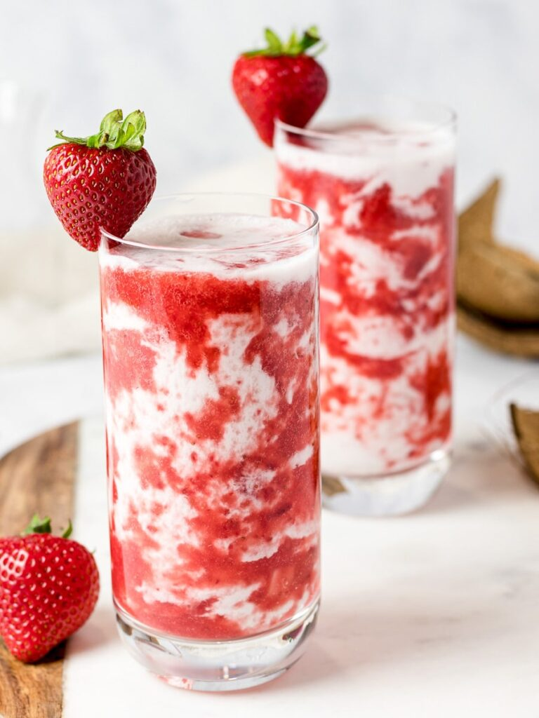 homemade Korean strawberry milk in two glasses with strawberries
