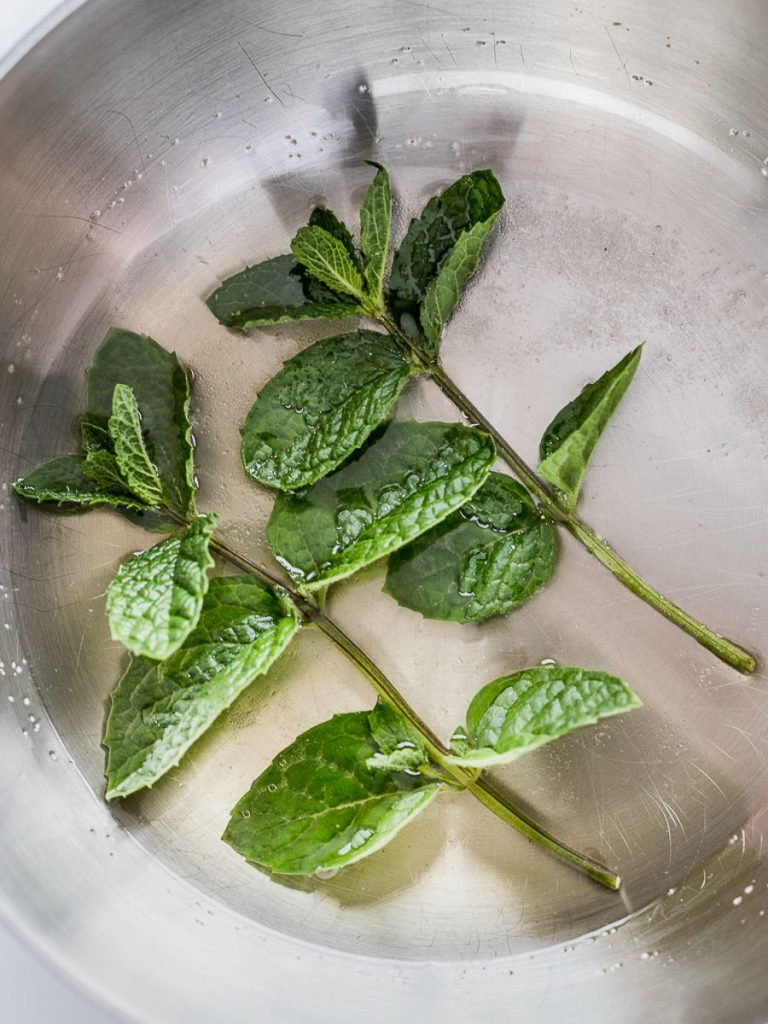 mint leaves in a silver pot for mint simple syrup