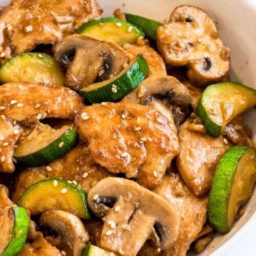 Panda Express Mushroom Chicken stir fry with zucchini in a white bowl