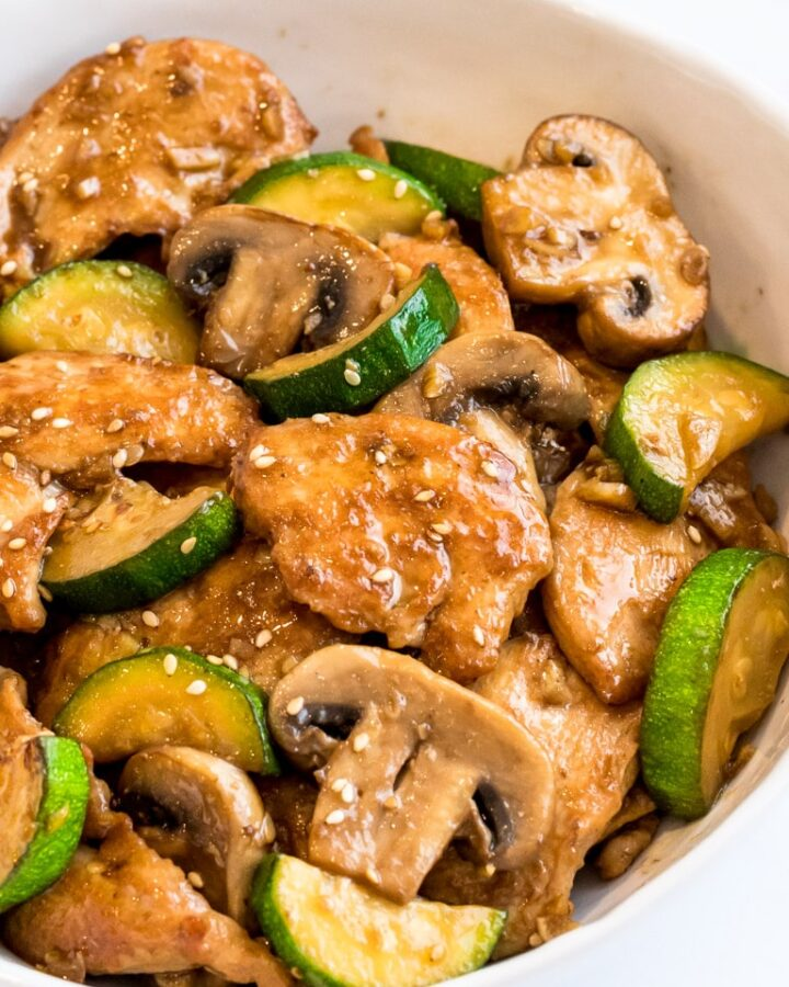 Panda Express Mushroom Chicken stir fry with zucchini in a white bowl