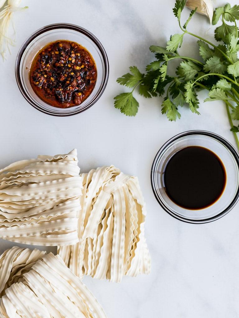 Szechuan chili oil noodles with soy sauce, cilantro, lao gan ma