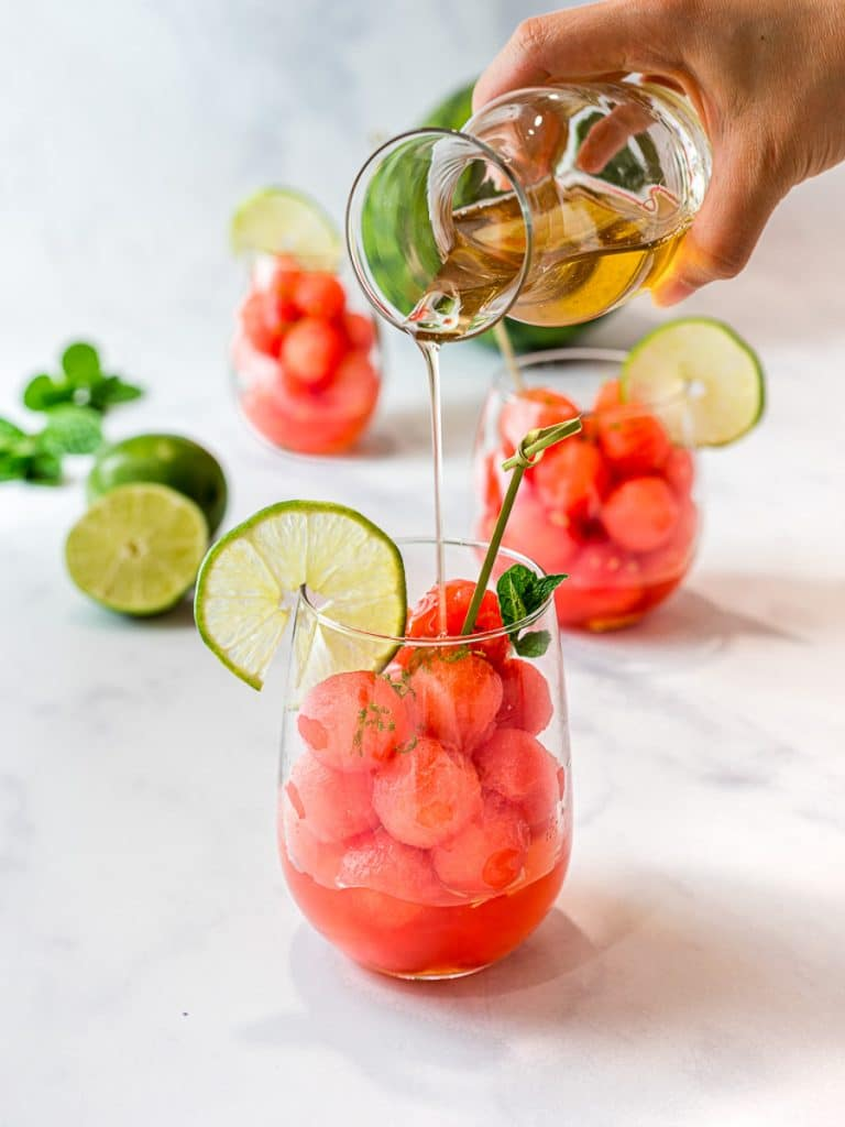 watermelon balls with lime and mint simple syrup in a clear glass cup