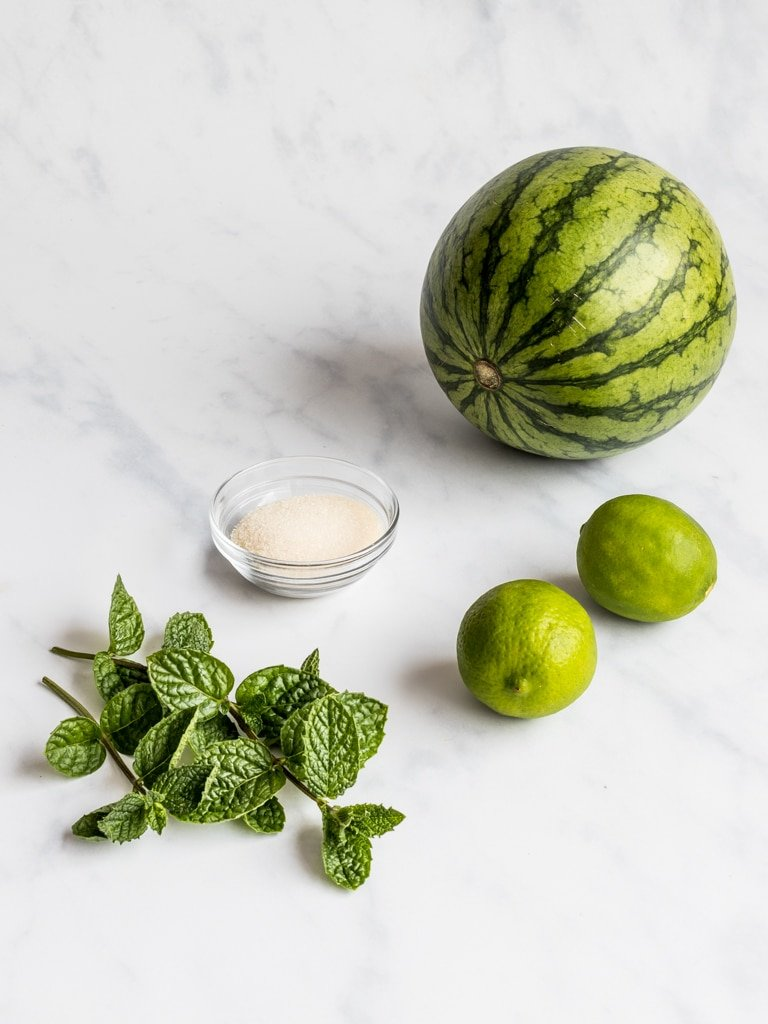 watermelon, lime, mint, and a bowl of sugar