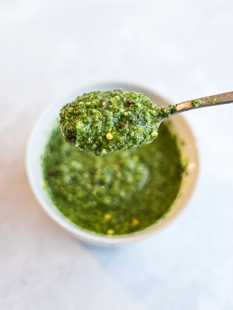 Asian chimichurri sauce on a spoon with white background