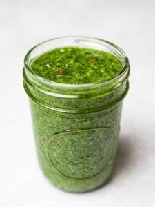 Asian chimichurri sauce in a glass mason jar