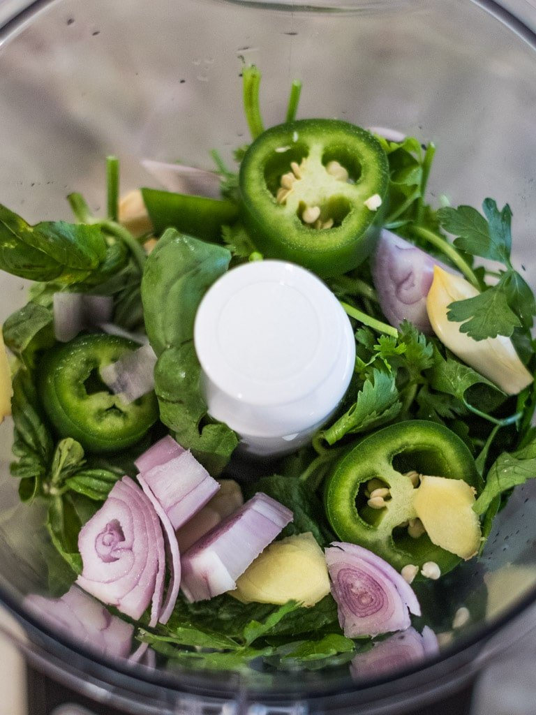 jalapenos, herbs, and shallots in a food processor