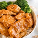 bowl of honey garlic chicken stir fry with steamed broccoli and steamed rice