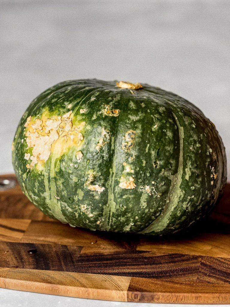 kabocha squash, Japanese pumpkin, Korean pumpkin danhobak on a wooden cutting board