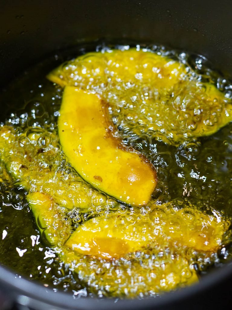 deep fried kabocha squash slices in oil