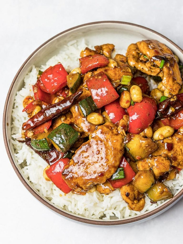 Panda Express Kung Pao Chicken Copycat on top of steamed rice in a bowl