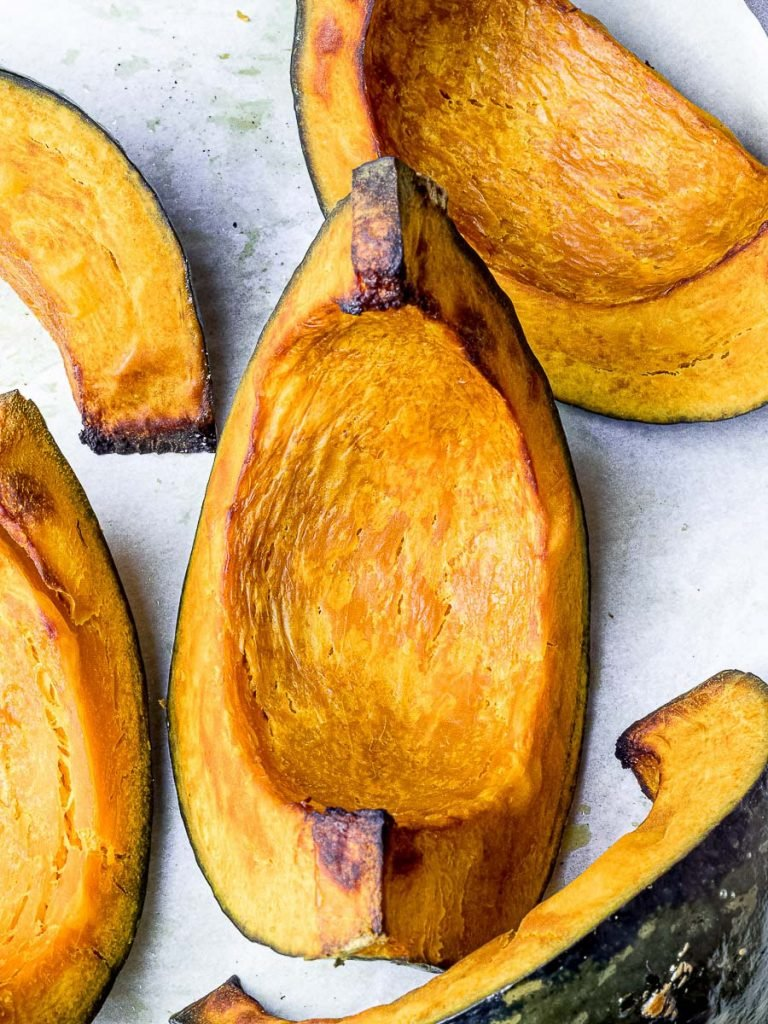roasted kabocha squash wedges on parchment paper