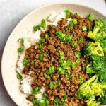 Korean beef bowl with rice, broccoli, and scallions; Korean bulgogi bowl