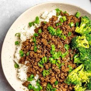 Korean beef bowl with rice, broccoli, and scallions; Korean bulgogi bowl