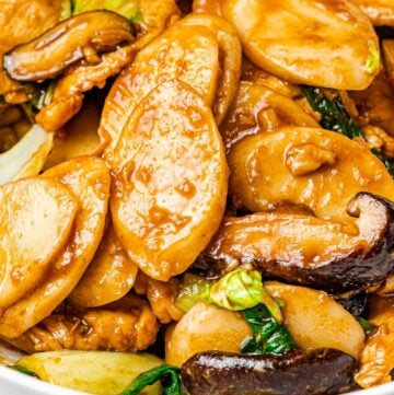 Stir Fried Shanghai rice cakes with mushrooms in a white bowl, Din Tai Fung Shanghai rice cakes, chao nian gao