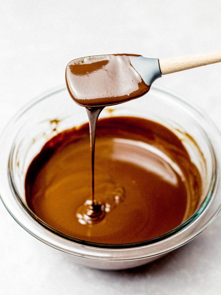chocolate ganache glaze dripping off a spatula