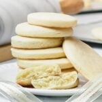 stack of soft cut out sugar cookies on a white plate