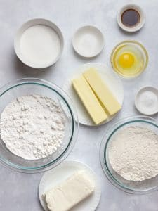 ingredients for soft cream cheese sugar cookies in glass bowls