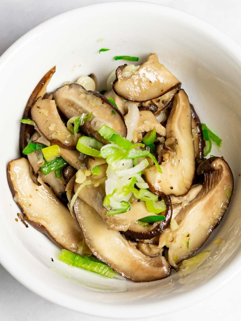 Korean shiitake mushroom side dish in a small white bowl