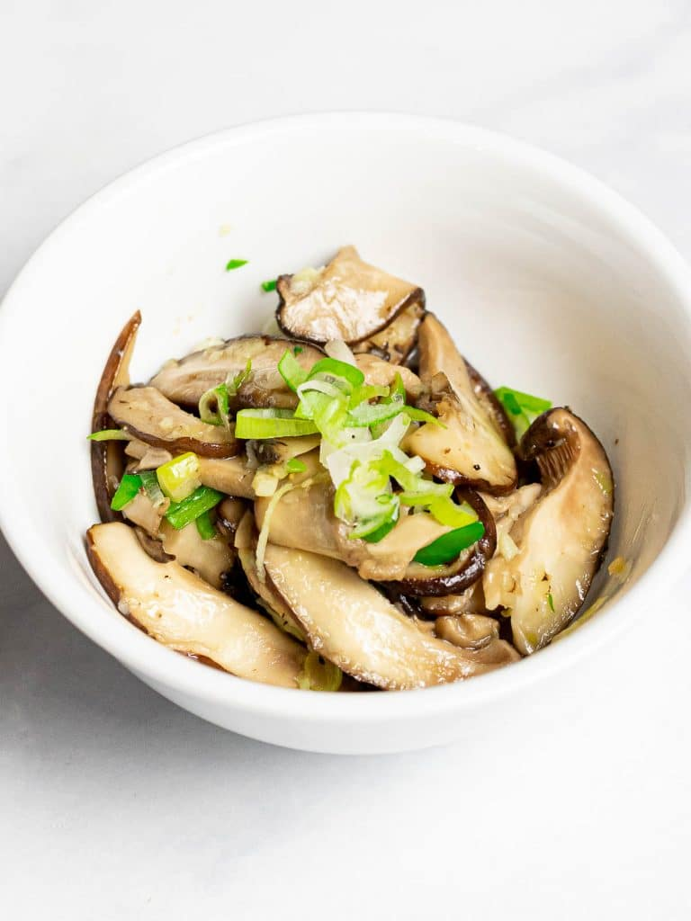 close up of Korean shiitake mushroom side dish in a small bowl