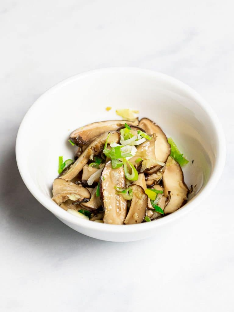 Korean mushroom side dish in a white bowl