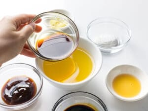 chicken stock, soy sauce, and sesame oil in glass ramekins