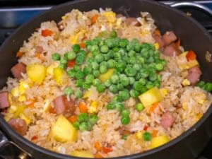 fried rice with pineapples and frozen peas