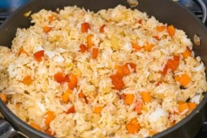 rice stir fried with carrots and red bell peppers with seasoning