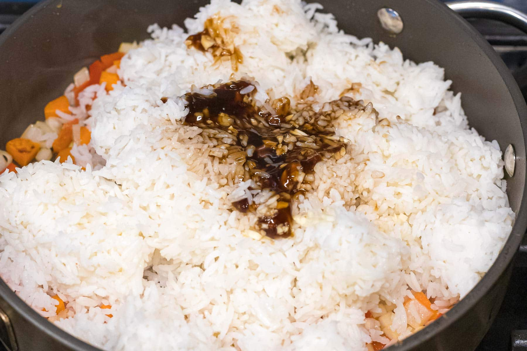 cooked rice with sauce in a nonstick pan